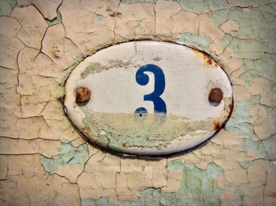 an old enamel number three sign